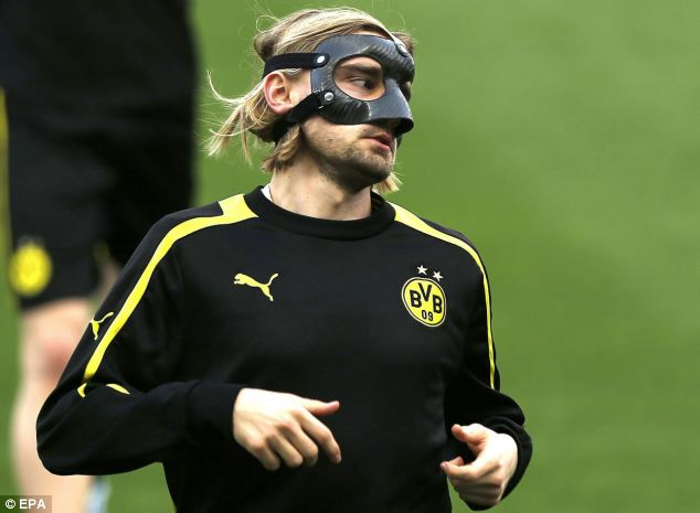 Masked man: Dortmund defender Marcel Schmelzer will be forced to wear a mask in Malaga