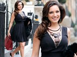 Smart, simple and flawless: Kelly Brook shows just how to do work chic in black dress and red heels as she heads to filming