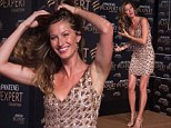What a tease! Gisele Bündchen wears tiny gold dress as she plays with her tresses to promote new shampoo