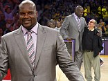 Former Los Angeles Lakers center Shaquille O'Neal stands with actor Jack Nicholson after they retired his jersey during the half of the Lakers' NBA basketball game against the Dallas Mavericks