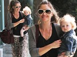 Like mother, like daughter: Rebecca Gayheart makes a statement in snakeskin skirt while little girl Georgia is adorable in starry trousers