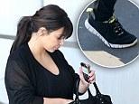 Swollen feet? Pregnant Kim Kardashian swaps her staple sky-high heels for comfy trainers