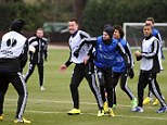 Larking around: Chelsea's John Terry and Juan Mata tussle during training