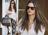 Alessandra Ambrosio shows off her flair for fashion in jazzy trousers while out shopping