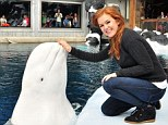 Talk to the hand: Nanuq couldn't get enough of Fisher when they met at Sea World San Diego on Tuesday