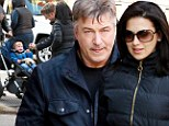 When does our one arrive? Pregnant Hilaria Thomas and birthday boy Alec Baldwin coo over baby during romantic stroll