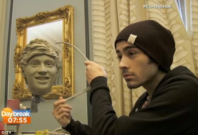 Does it measure up? Zayn gets to grips with his head during the sculpting session