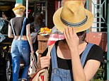 Mystery shopper: Diane Kruger hid her face beneath a straw hat as she shopped in Los Angeles