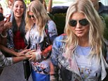 They Got A Feel-ing! Fergie happily lets her doting Brazillian fans touch her baby bump as she visits an NGO in Rio de Janeiro