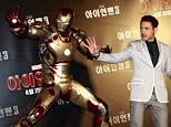 Maybe he can stop World War 3! Robert Downey Jr. takes Iron Man to South Korea for press conference
