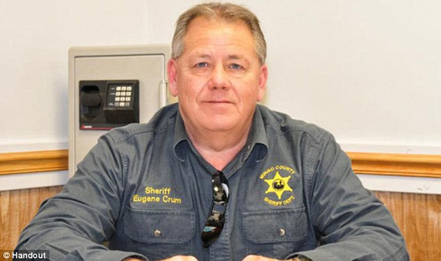 Killed: Mingo County Sheriff Eugene Crum died of his wounds on Wednesday after being shot on the streets where he regularly parks his car for lunch