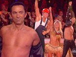 Dancing With... no shirt on! Bruno Tonioli strips off studded leather jacket during YMCA routine on DWTS