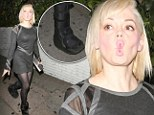 Rose McGowan's boot-iful night-time look as she camouflages foot cast with dark tights and dress