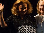 Fashion star: Diane von Furstenberg debuted a snazzy custom-made arm sling as she stepped up to the stage with Hillary Clinton (right) at the 2013 Vital Voices Global Awards