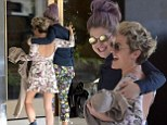 They're fashion friends! Kelly Osbourne and Jaime Winstone show off matching floral outfits as they meet up in America