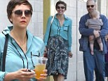Almost a Marilyn moment! Laid back Maggie Gyllenhaal and husband Peter Sarsgaard enjoy a breezy afternoon with their family