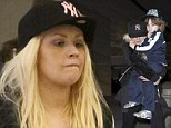 hristina Aguilera touches down at LAX this afternoon with her hands full as