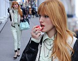 Bella Thorne, star of Disney's Shake It Up wears a teal pantsuit as she gets to business in New York City