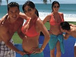 Ready for baby number two!: Mario Lopez kisses wife Courtney Mazza's bump during Mexican vacation