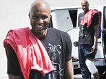 Putting on a brave face: Smiling Lamar Odom is pictured for the first time since being accused of 'operating a fraudulent $2.2 million cancer charity'