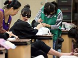 Heads, shoulders, knees and toes: Kim seemed to enjoy the pampering session after jetting in from Paris