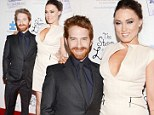 Little and large! Seth Green is towered over by wife Clare Grant as she shows some cleavage at his film premiere