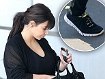 Swollen feet? Pregnant Kim Kardashian swaps her staple sky-high heels for comfy trainers