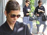 That's a little wide of the fashion mark! Halle Berry drowns out her famous figure with a pair of bizarre harem trousers