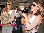 Doting mother: Gisele Bundchen carried baby Vivian as the two arrived in Sao Paulo, Brazil, on Tuesday