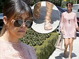 Get me to the Greek! Kourtney Kardashian glides in gladiator sandals en route to Kim¿s house