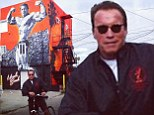 Check me out! Arnold Schwarzenegger stops for a photo in front of Venice Beach mural depicting him in his younger days