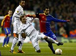 On the slide: Tottenham's Lewis Holtby challenges Basle's Mohamed Salah
