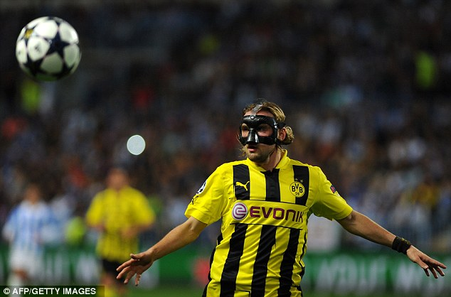 Man in the mask: Schmelzer keeps his eyes the ball during the tie