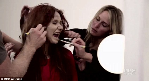 Quick touch-up: Karen gets a helping hand from her 'make-up artists' as part of the commercial