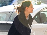 Gym bunny: Katie Holmes headed to the gym in New York City on Thursday in her usual casual ensemble, but wore an ID badge showing her looking a lot more glamorous