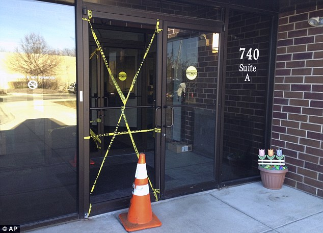Smashed: The officer fired a shot which smashed the entrance to the Vernon Hills Police Department, pictured