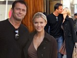Go back to your room! Real Housewives star Joanna Krupa and fiance Romain Zago put on brazen PDA while leaving hotel