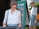 Welcome shoppers! Taylor Swift cuts a demure figure in white blouse and grey skirt at Bristol Farms