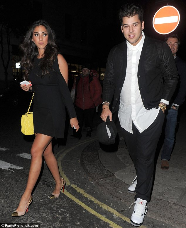 Mystery girl: Rob Kardashian was seen leaving Nobu restaurant in Mayfair, London on Tuesday with a pretty brunette