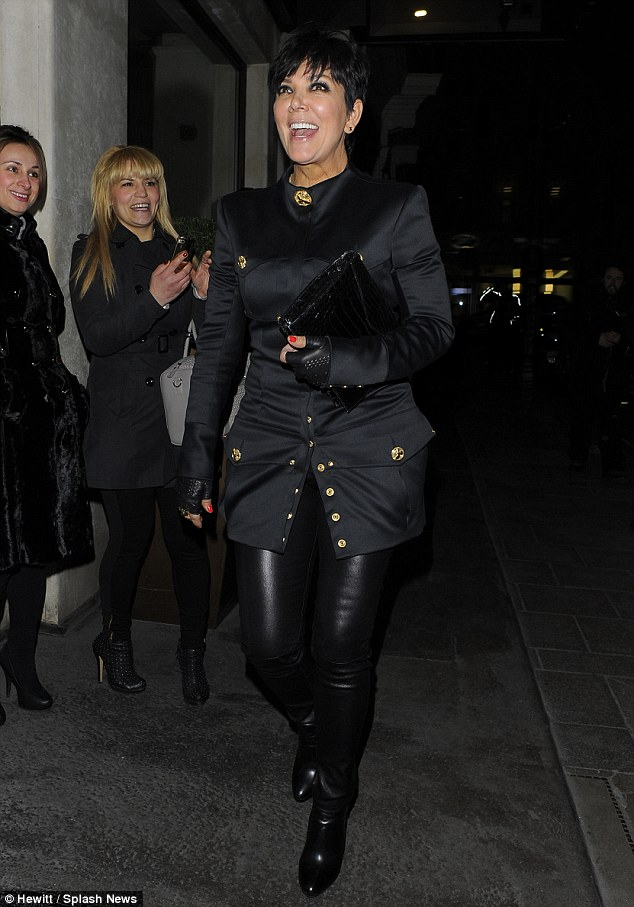 High spirits: The reality star smiled broadly as she made her way to the posh eatery
