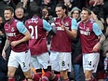 Up in the air: Andy Carroll (centre) is due to return to Liverpool following his loan spell at West Ham