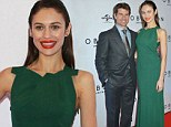 Doing the Emerald Isle proud: Stunning Olga Kurylenko charms the Irish in green gown as she towers over Tom Cruise at Dublin premiere of Oblivion