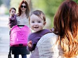 Time for a pick-me-up! Alyson Hannigan cradles her little sweetheart on afternoon coffee run