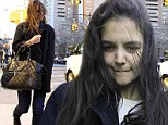 Make-up free Katie Holmes suffers a bad hair day as she gets swept up in a gust of wind