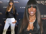 Well it is a nice bra! Kelly Rowland shows off her lacy lingerie in unbuttoned blouse at drinks party