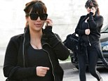 Pregnant Kim Kardashian hides her figure in slimming black as she goes for a make-up free early morning workout