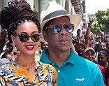 Police are called to keep Beyonce and Jay-Z safe in Cuba as they are mobbed by fans while eating in Havana