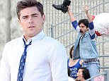 Odd pairing: Zac Efron showed off his dapper sense of style while Jake Johnson feigned illness on set of Townies shooting in Los Angeles, on Thursday