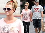Britney Spears let her hair down for a date with David Lucado on Wednesday