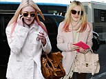 Dakota Fanning gets ready to check in at LAX on her way to